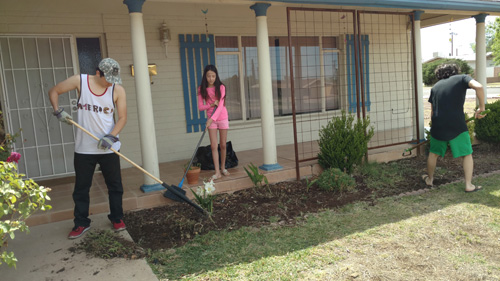 The kids cleaning the flower bed resized
